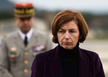 French Defence Minister Florence Parly arrives at the French army's EALAT light-aircraft training school in Cannet-des-Maures on February 2, 2018, after two army helicopters crashed into each other. Five people were killed today after two army training helicopters crashed into each other near a lake in southern France, police said, one of the deadliest such accidents involving the country's armed forces in recent years. The cause of the collision was still unclear. All the people on board were officers, a source close to the inquiry said.  / AFP / Anne-Christine POUJOULAT