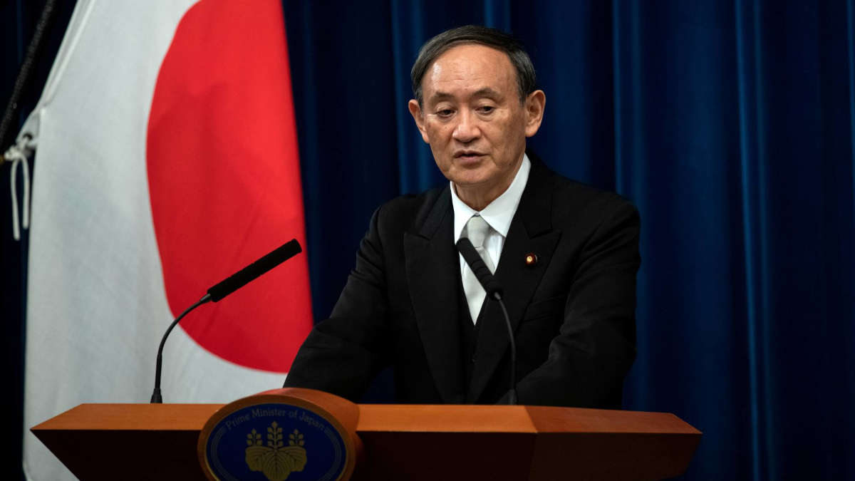 Yoshihide Suga. Photo : Carl Court/Pool via REUTERS/File Photo