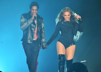 "GLASGOW, SCOTLAND - JUNE 09:  Beyonce and Jay-Z perform together holding hands on stage during the ""On the Run II"" Tour at Hampden Park on June 9, 2018 in Glasgow, Scotland.  (Photo by Kevin Mazur/Getty Images For Parkwood Entertainment)"
